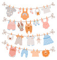baby clothes on rope newborn children apparel vector image vector image