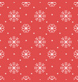 christmas pattern with white snowflakes on a red vector image