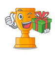 with gift champion golden trophy on cartoon table vector image