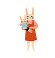 mother bunny and her kid loving parent animal and vector image vector image