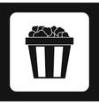 Popcorn in striped bucket icon simple style vector image vector image