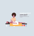 young man having back massage african american vector image vector image