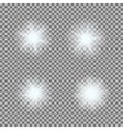set of glowing light bursts on grey white vector image