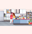 couple embracing and kissing at kitchen counter vector image