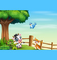 animal cartoon playing inside fence vector image vector image