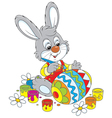 Bunny paints an Easter egg vector image vector image