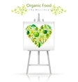 Vegetarian heart on canvas and easel green lime vector image