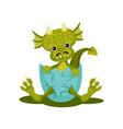 funny baby dragon in blue broken egg shell green vector image