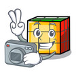photographer rubik cube mascot cartoon vector image vector image
