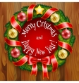 A Christmas wreath on wooden planks background vector image