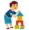cheerful child builds high tower colorful vector image vector image
