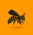 honey bee silhouette on orange background vector image vector image