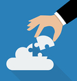 Hand inserts the missing puzzle in cloud vector image vector image