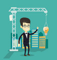 man pointing at idea bulb hanging on crane vector image vector image