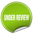 under review round green sticker isolated on white vector image vector image