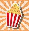 popcorn food in striped bucket on sunburst vector image