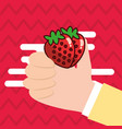 hand holding strawberry fresh colored background vector image vector image