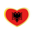 flag of albania in heart shape golden frame vector image