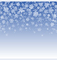 snowflakes falling on blue background vector image vector image