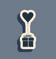 black gift with balloon in shape heart icon vector image vector image