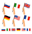 hands holding flags of different countries vector image