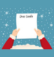 santa is holding in his hands reading a letter vector image vector image