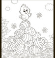 little easter chick on a pile of decorated eggs vector image vector image