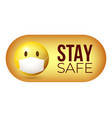 stay safe yellow emoji icon in face mask badge vector image vector image