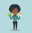african woman choosing between apple and cupcake vector image vector image