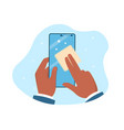 hand is holding and cleaning mobile phone screen vector image