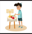 little boy in yarmulke eat apple with honey vector image vector image