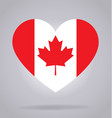 canada flag in heart shape vector image