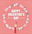 hand holding smartphone for valentines day vector image vector image