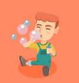 little caucasian boy blowing soap bubbles vector image vector image