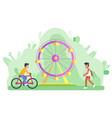 ferris wheel amusement park and bicyclist man vector image vector image