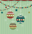Three Christmas balls on striped background vector image