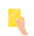 hand holding yellow football card vector image vector image