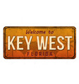 welcome to key west vintage rusty metal sign vector image