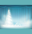 glowing christmas tree on a blue curtain vector image vector image