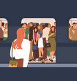 subway car crowded with people in rush hour woman vector image