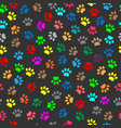 colorful animal paw prints seamless pattern vector image vector image