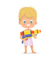 smiling cute blond baboy with a toy water gun vector image vector image