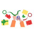 hands with scissors pack gifts vector image vector image