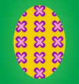 Yellow easter egg with flower pattern vector image vector image