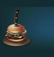 cheeseburger stabbed with a knife on round wooden vector image