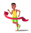 runner guy in competitions crosses the finish line vector image
