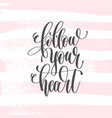 follow your heart - hand lettering poster on pink vector image vector image
