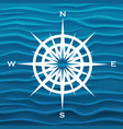 wind rose over blue waves background vector image vector image