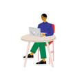 young man sitting at desk and working on laptop vector image vector image