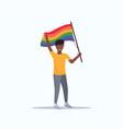 man gay holding lgbt rainbow flag love parade vector image vector image